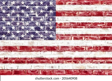 An American flag on a brick wall used as a wallpaper or background