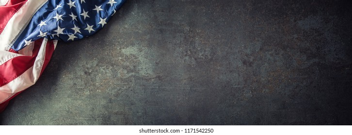 American flag on dark concrete with free space. 4th July Veterans or US Independence day.