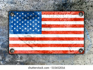 American flag on metal plate screwed screws on wall. Old grunge background
