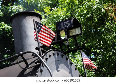American flag on an old steam train