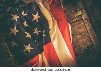 American Flag on the Reclaimed Wood Crate Closeup Photo. United States of America Country Vintage Theme.