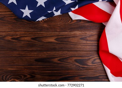 American flag on the right and top side on a wooden background