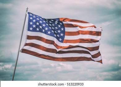 american flag on sky background, toned like instagram filter