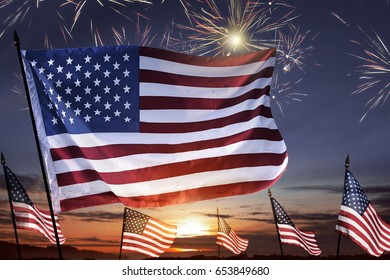 American flag on the sky waving celebrating 4th of July with fireworks background