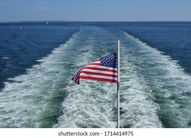 american flag on the stern of a ship