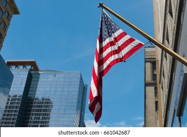 American flag on a street of Chicago downtown