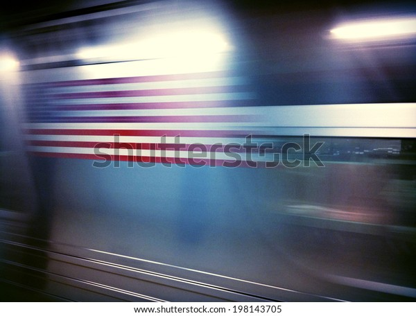 American flag on subway car traveling in motion underground in New York City with Instagram effect filter.