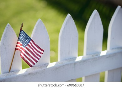American Flag on white picket fence for US holidays like Memorial or Labor Day.