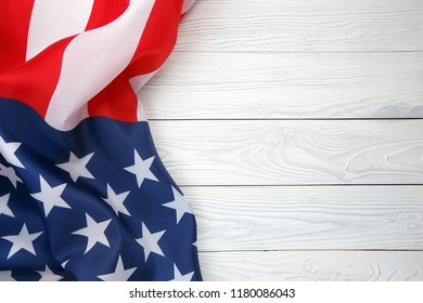 American flag on white wooden board