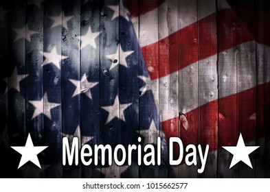 An American flag on wood with the words Memorial Day in white.