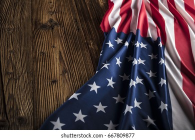 American flag on wooden background.