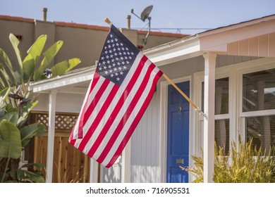 american flag outside a house