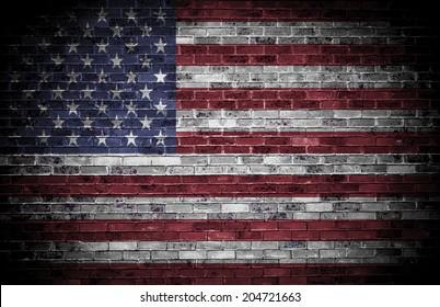 American flag over a grunge brick background.