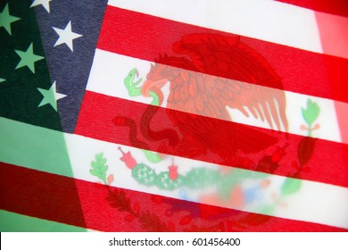 American flag over Mexican flag closeup