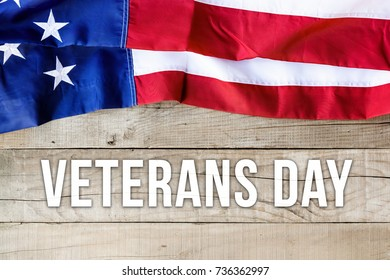 American flag over wooden background - Veterans Day card