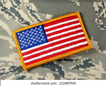 American flag patch on camouflage background