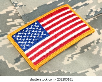 American Flag patch on camouflage uniform