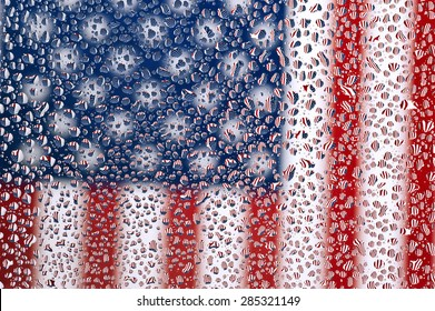 An American flag photographed through water drops on glass, creating many tiny mirror images of the flag/ American Flag Under Drops Of Water