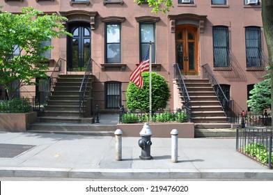 American Flag Pole Brownstone home USA