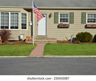 American flag pole closeup view Suburban home landscaped lawn sunny residential neighborhood autumn day USA