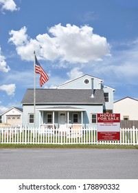American Flag pole real estate for sale open house welcome sign Suburban Home Residential neighborhood USA Blue Sky Clouds