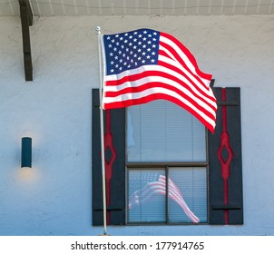American Flag Reflecting in the Window of a Storefront in Leavenworth WA USA