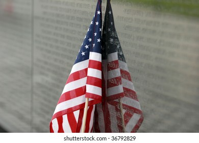 American flag rests against the Vietnam Wall in Washingotn DC
