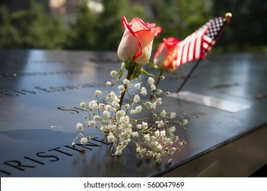 American flag, rose and flower at the 911 memorial world trade center, New York
