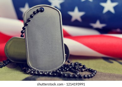 American flag and soldiers badges.Veterans Day Concept.