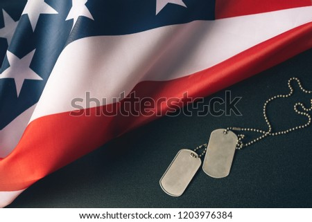 dd072bd63573 American flag and soldiers tags on wooden background.Veterans Day Concept.