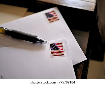 American Flag Stamps on Letters Ready to be Mailed