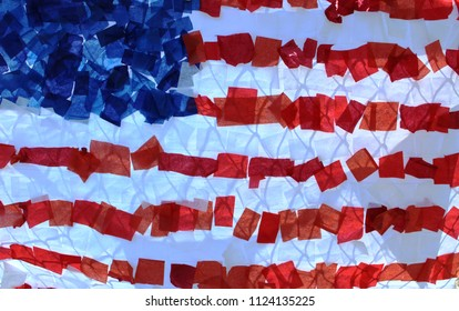 American Flag Stars and Stripes made of crepe paper streamer bits. Red white and blue. Background.