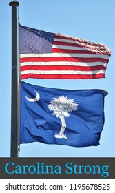 """American Flag and The State of South Carolina Flag blowing in the wind with the message """"Carolina Strong"""" offers support in the aftermath of Hurricane Florence."""