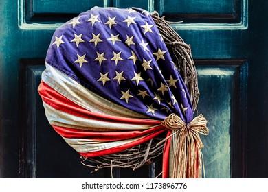 An American flag style wreath hangs on a door in Philadelphia, PA.