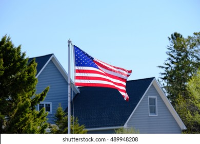 American flag at suburban neighborhood