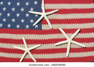 American flag with three white starfish. Summertime / seashore concept.