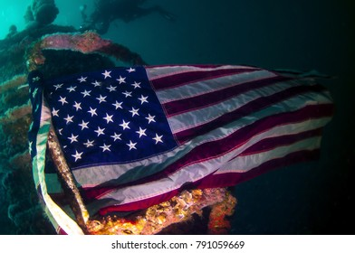 An American flag tied to the super structure of a sunken ship
