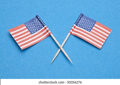 5d0aa1ad5517 American Flag toothpicks on a blue background. Great Patriotic July 4th  Image.
