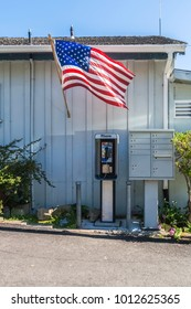 The american flag upon a public phone and some mailboxes California.