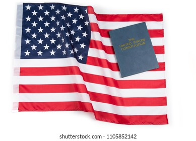 American flag with US constitution or holy bible.