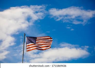 American flag. US flag waving . Blue sky backgroung
