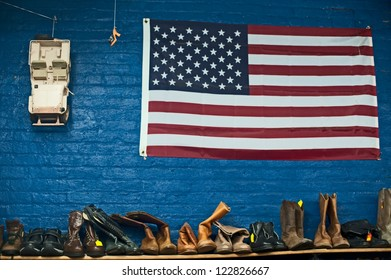 American flag and used boots in thrift store