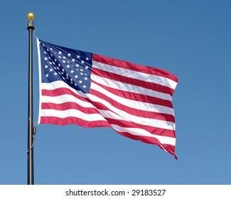 American flag waving against blue sky. See similar in my portfolio.