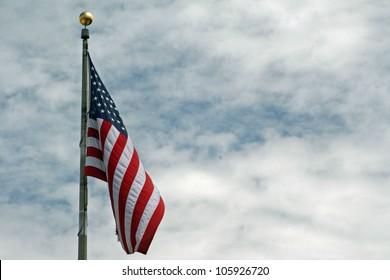 American flag waving against the sky