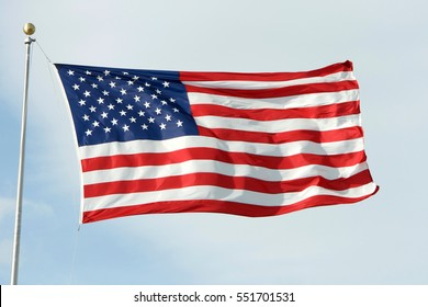 American Flag waving, blowing in the wind