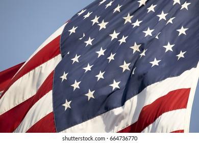 American flag waving blue background