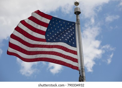 american flag waving with blue sky