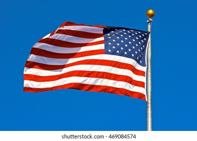 American flag waving in clear blue sky