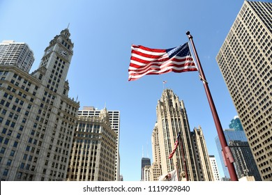American flag waving in downtown of Chicago, USA