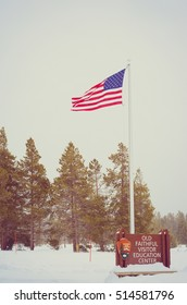 American flag waving with snow background at Yellowstone national park